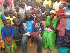 Deogratias with children in burundi